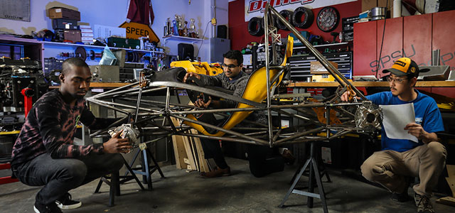 Students working on KSU's motorsports car