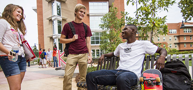 Students siting by the courtyard